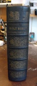 The remains of the original spine are then pasted down onto the new one.