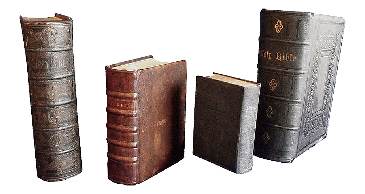 The same four Bibles after they had been restored. Bible repair