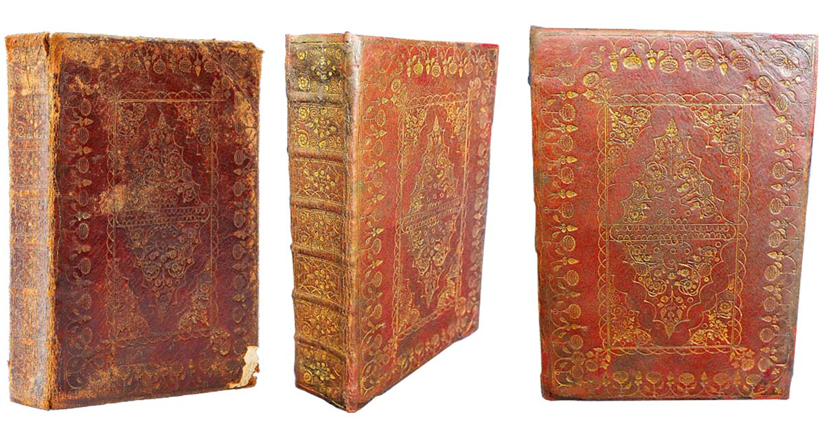 A beautifully bound 17th century Bible that was in need of restoration (left). The same Bible after restoration (centre & right). Bible restoration