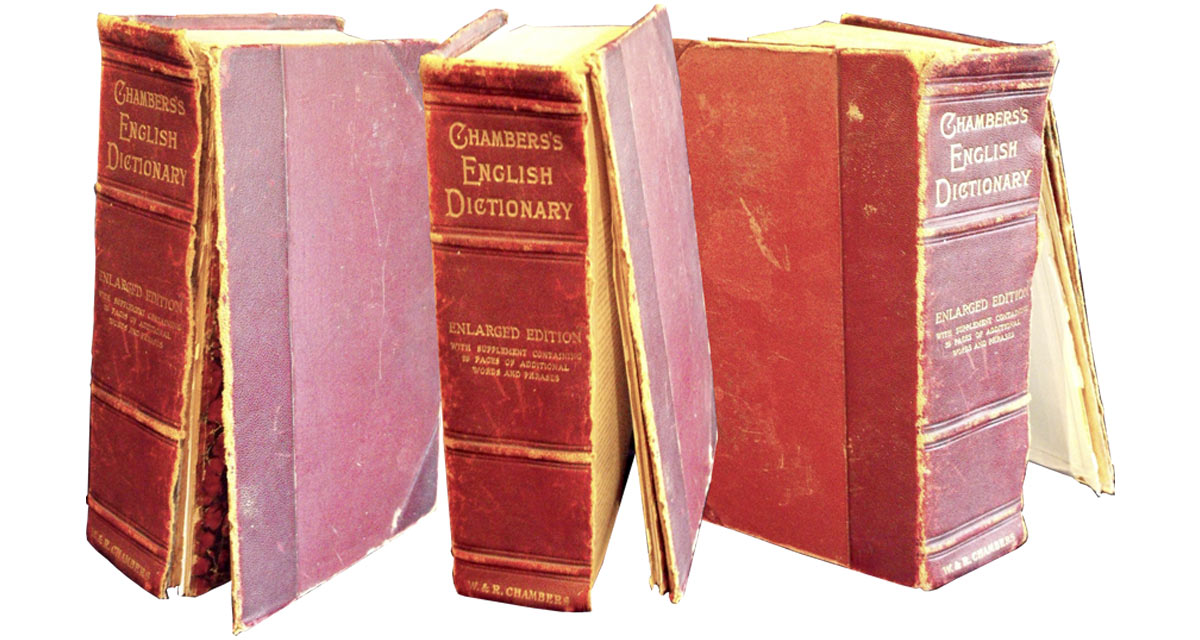 An Edwardian edition of Chambers dictionary in need of spine repair