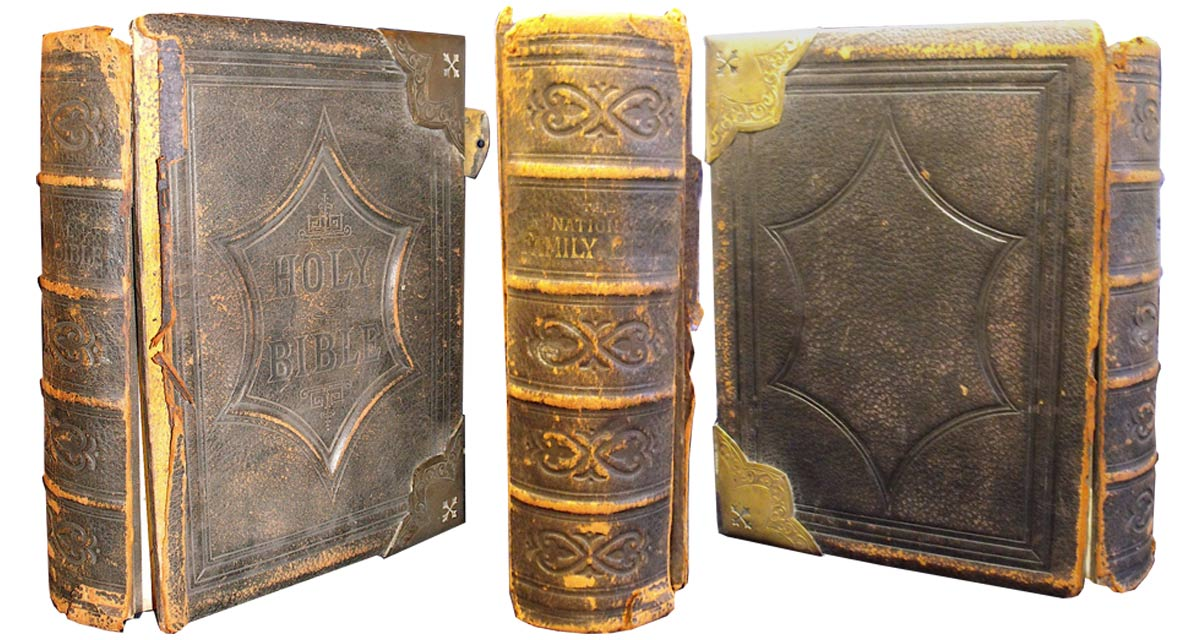 This family Bible had detached covers and a worn spine.